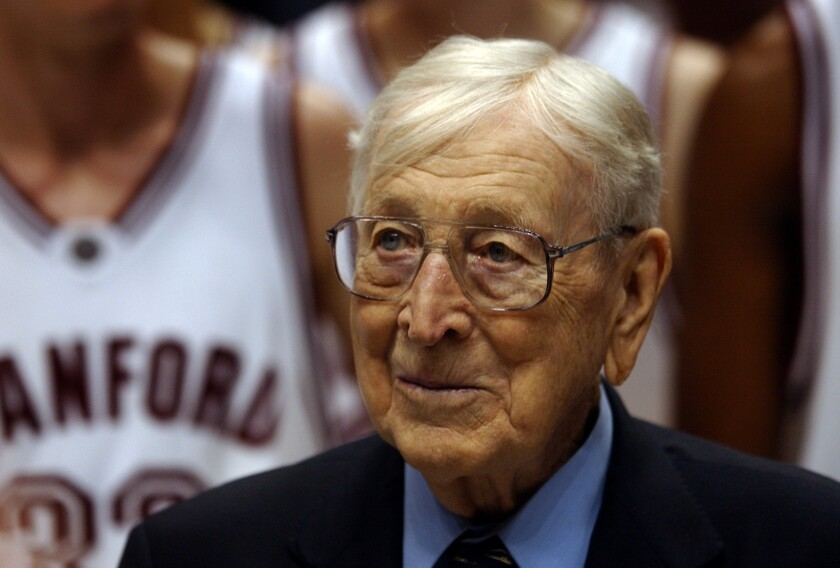 John Wooden catches the inaugural John R. Wooden Classic in December 1994.