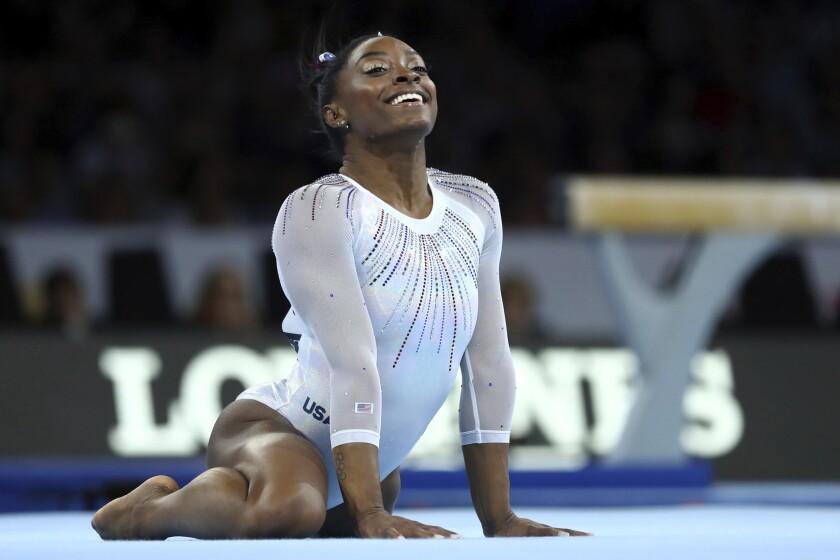 Simone Biles won her fifth all-around world gymnastics title Thursday in Stuttgart, Germany.