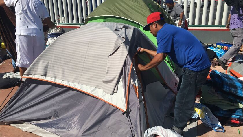 Volunteers tear down the makeshift camp after the last of the Pueblo sin Fronteras immigrant caravan members from Centeal America entered the US Friday morning