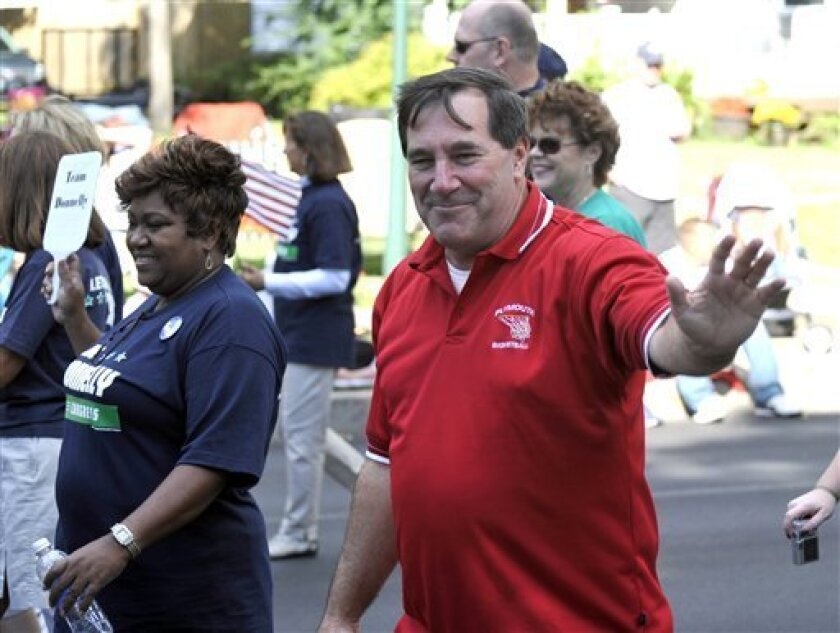 """FILE - In this Sept. 6, 2010, file photo Rep. Joe Donnelly, D-Ind. waves to spectators at the Blueberry Festival Parade in Plymouth, Ind. The two-term Democrat is campaigning as an independent lawmaker who opposed one of Obama's signature bills and advertises against it as """"Nancy Pelosi's energy tax on Hoosier families."""" Conservative Indiana provided the first sign of a Democratic sweep in 2006. With unemployment is measured at 10.2 percent and newspapers run page after dreary page of home foreclosure notices, Indiana could again be an early indicator of the national trend. (AP Photo/Joe Raymond, File)"""