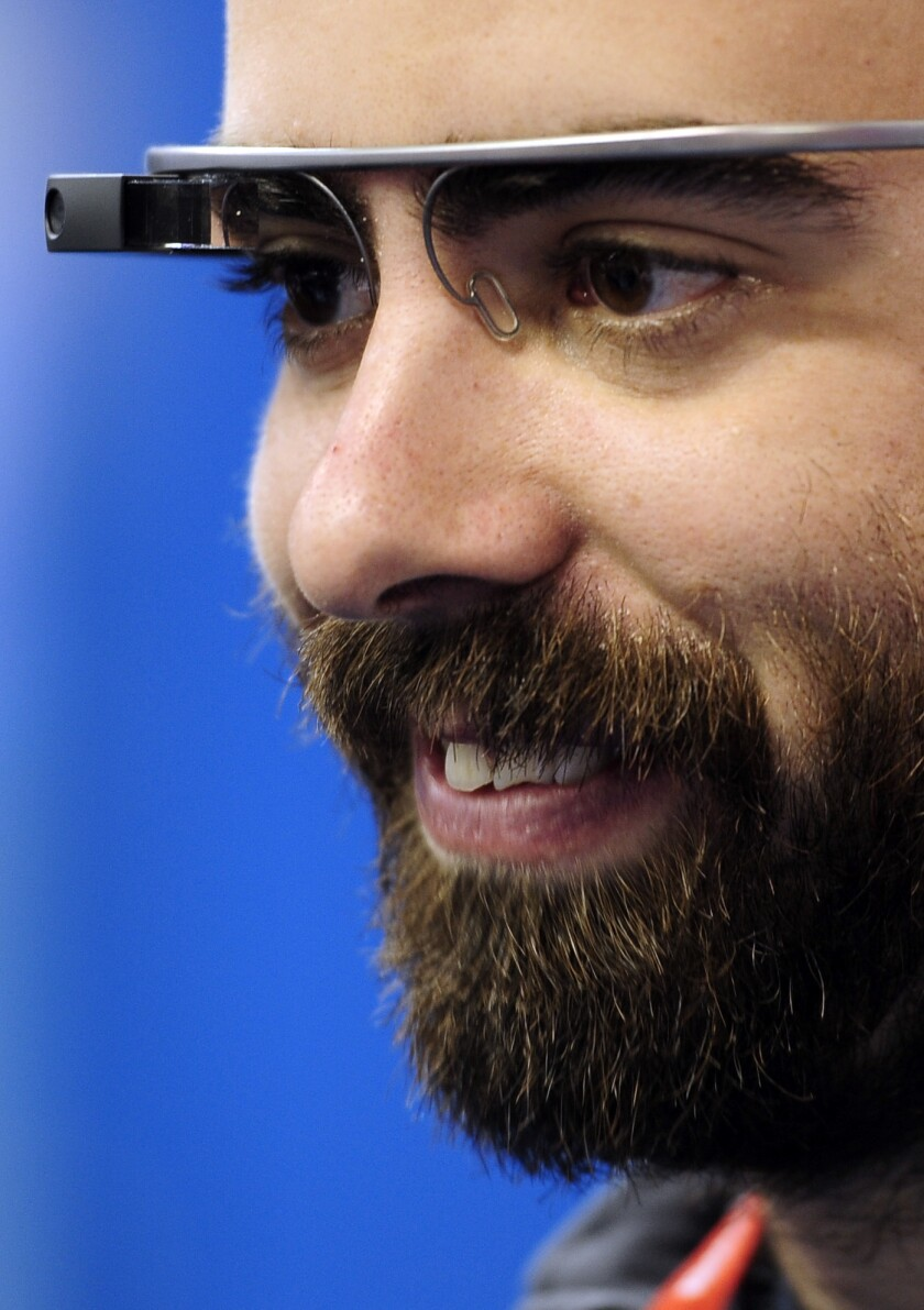 A visitor uses the Google Glass at the Mobile World Congress, the world's largest mobile phone trade show, in Barcelona, Spain. Privacy concerns have prompted some businesses to prohibit them.