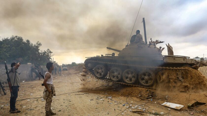 Fighters loyal to the Libyan internationally recognized Government of National Accord (GNA) are pictured near the front line during clashes against forces loyal to Khalifa Haftar, on June 1 in al-Sawani area, south of the Libyan capital, Tripoli.