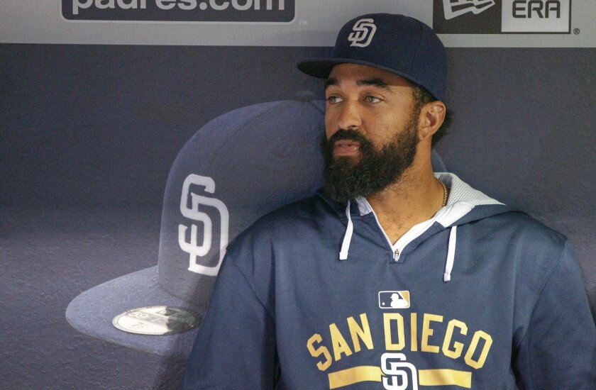The Padres' Matt Kemp sits in the dugout before the start of the Padres game against the Brewers.