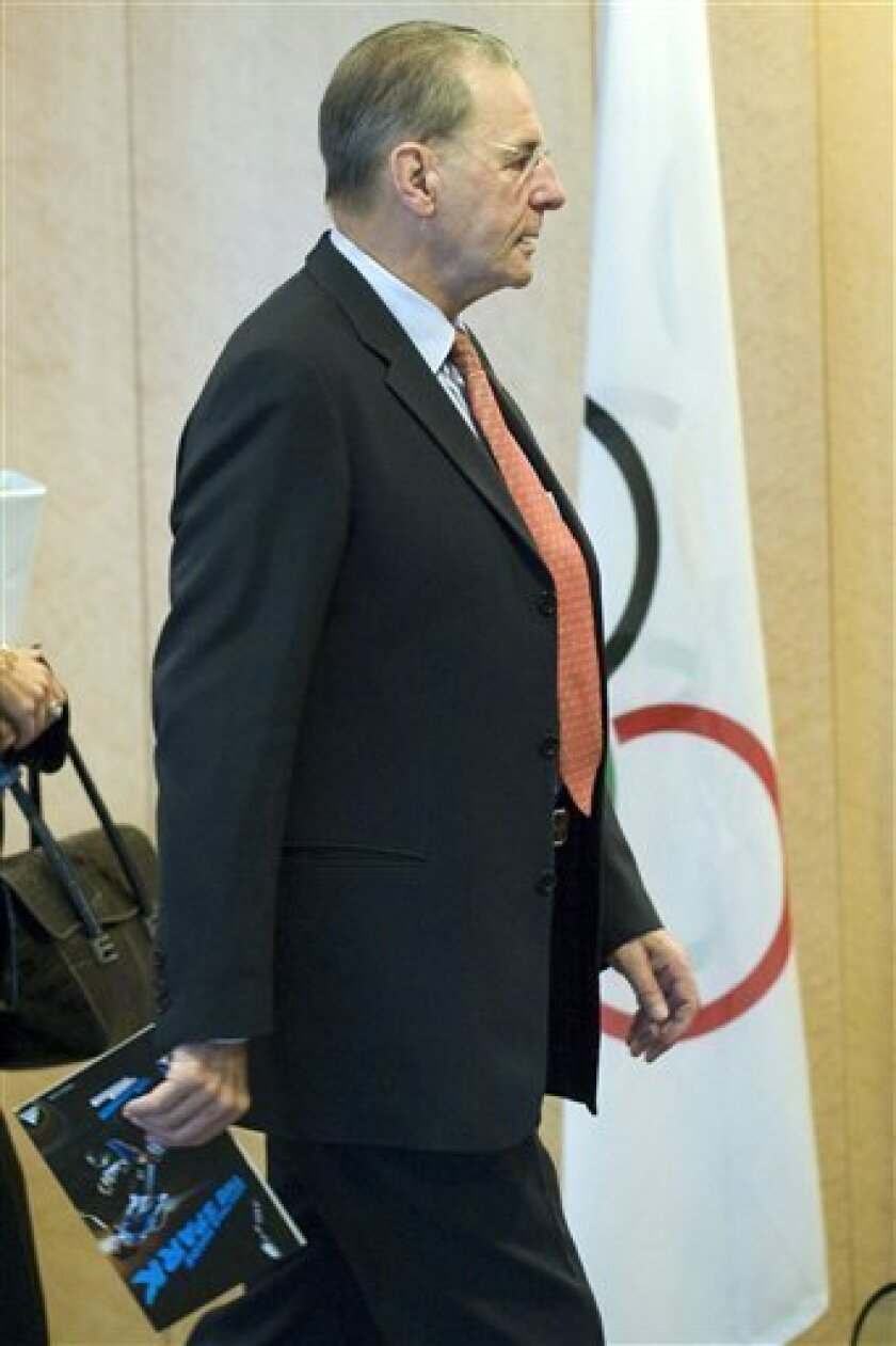 International Olympic Committee, IOC, President Jacques Rogge, from Belgium, arrives for the opening of the executive board's meeting, at the IOC headquarters in Lausanne, Switzerland, Wednesday, Dec. 9, 2009. (AP Photo/Keystone, Laurent Gillieron)