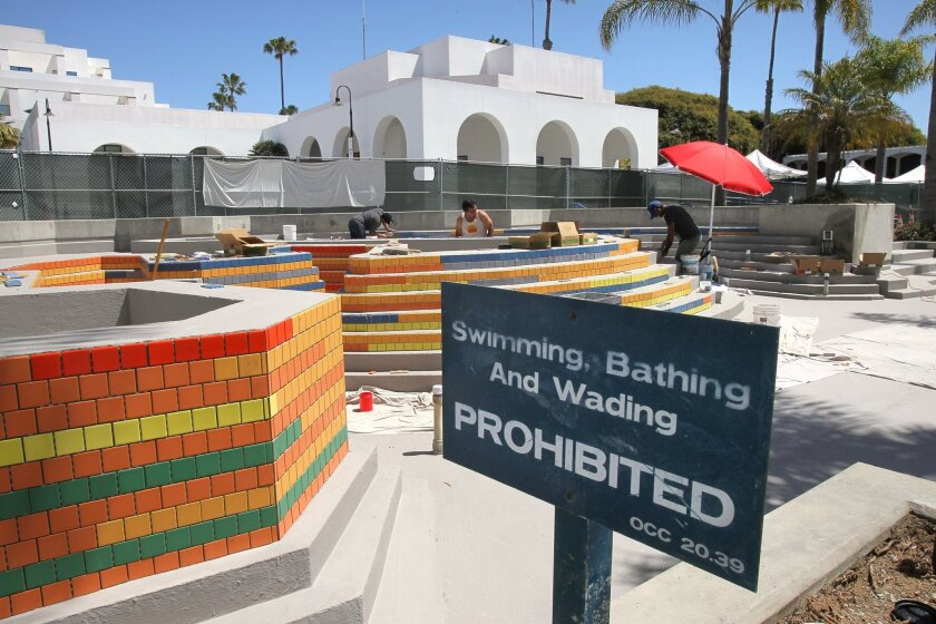 A sign warns against entering the fountain that's being renovated at Oceanside Civic Center. The renovation is nearly complete.