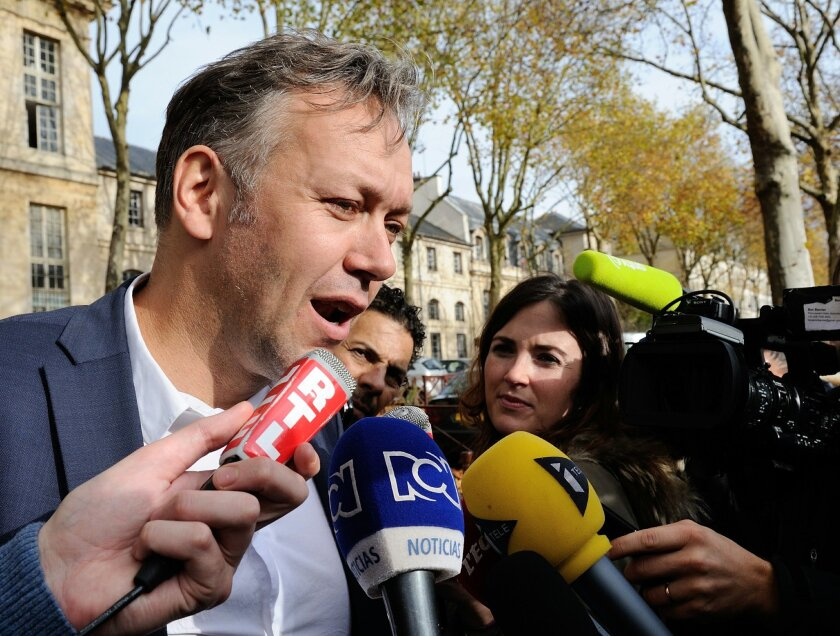 Karim Benzema's lawyer Sylvain Cormier answers questions as he meets the media in front of a police station in Versailles, south of Paris, France, where his client is being questioned, Wednesday, Nov. 04, 2015. France striker Karim Benzema will remain in custody overnight after being questioned on