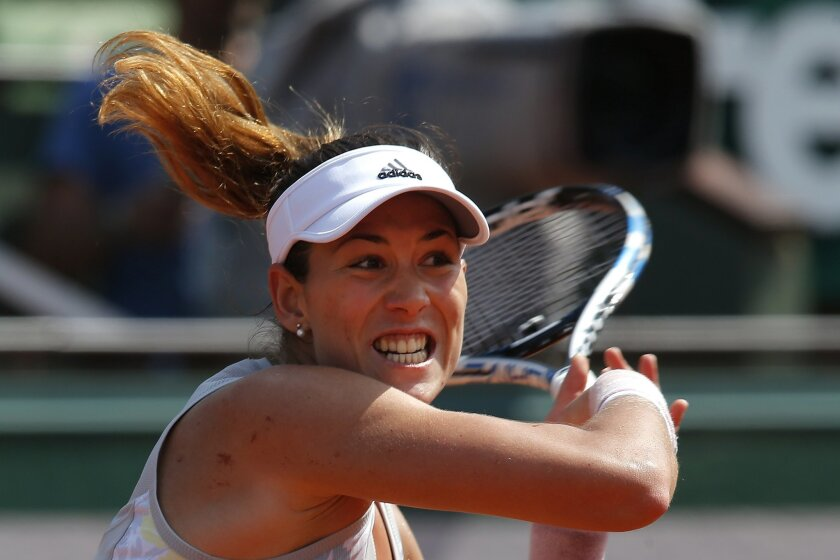Spain's Garbine Muguruza slams a forehand to Belgium's Yanina Wickmayer during their third round match of the French Open tennis tournament at the Roland Garros stadium, Friday, May 27, 2016 in Paris.  (AP Photo/Michel Euler)