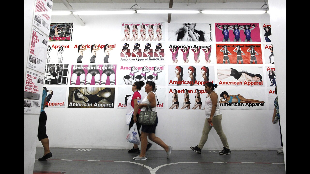 American Apparel garment workers arrive for work at the Los Angeles headquarters in 2014.