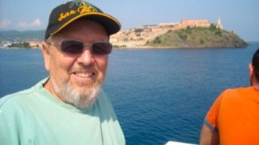 During one of his travels, author Jeffrey Crimmel takes a boat to Alba, Italy.