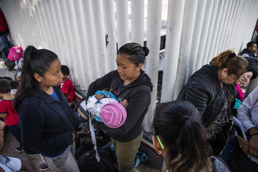 TIJUANA, MEXICO - JUNE 14, 2018: Eulalia Dalila Pojoy Cuyuch, 33 of Guatemala, holding 6-month-old