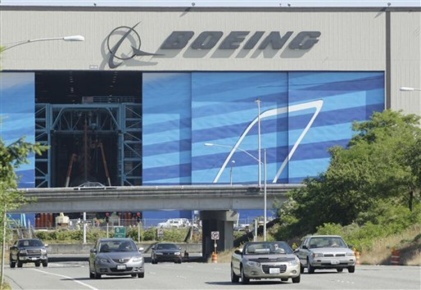 In this July 9, 2008 file photo, cars drive away from Boeing Co.'s Everett, Wash. assembly plant. Airplane maker Boeing Co. said Friday, Jan. 9, 2009, it plans to cut about 4,500 jobs this year due to the global economic slowdown. (AP Photo/Ted S. Warren, file)