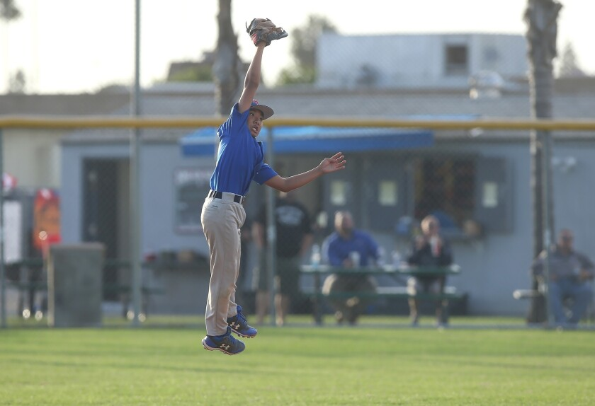 Huntington West's Ryo DeGuzman leaps to catch ball for an out during District 62 Tournament of Champ