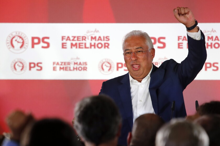 Portuguese Prime Minister and Socialist Party leader Antonio Costa raises his fist while addressing supporters following the announcement of election results in Lisbon Sunday night, Oct. 6, 2019. Portugal's center-left Socialist Party got the most votes in Portugal's general election Sunday, leaving it poised to continue leading the government for another four years. (AP Photo/Armando Franca)