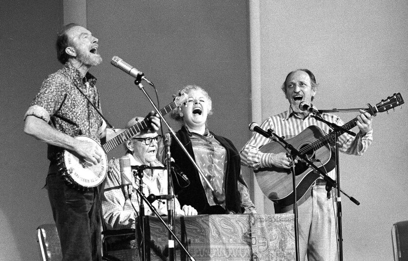 FILE - In this Nov. 28, 1980, file photo, the Weavers perform in a 25th Anniversary reunion concert at Carnegie Hall in New York. From left are: Pete Seeger, Lee Hays, Ronnie Gilbert and Fred Hellerman. Hellerman died Thursday, Sept. 1, 2016 at his home in Weston, Conn., after a lengthy illness, hi