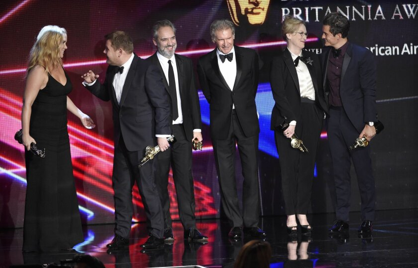 From left, honorees Amy Schumer, James Corden, Sam Mendes, Harrison Ford, Meryl Streep and Orlando Bloom, mingle onstage at the BAFTA Los Angeles Britannia Awards on Oct. 30, 2015.