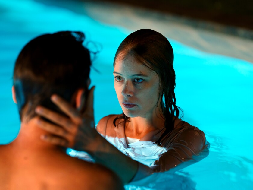 """Jacob Matschenz and Paula Beer in a swimming pool in the 2020 drama """"Undine."""""""