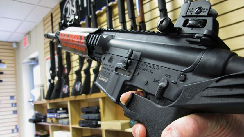 An employee of North Raleigh Guns demonstrates how a bump stock works at the Raleigh, N.C. shop on Feb. 1, 2013.