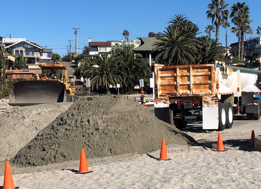Crews began pouring sand on the beach at 7 a.m. on Feb. 6