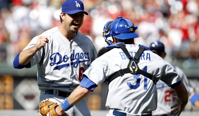Dodgers catcher Drew Butera celebrates with pitcher Josh Beckett after he struck out Chase Utley to complete a no-hitter on Sunday afternoon in Philadelphia.