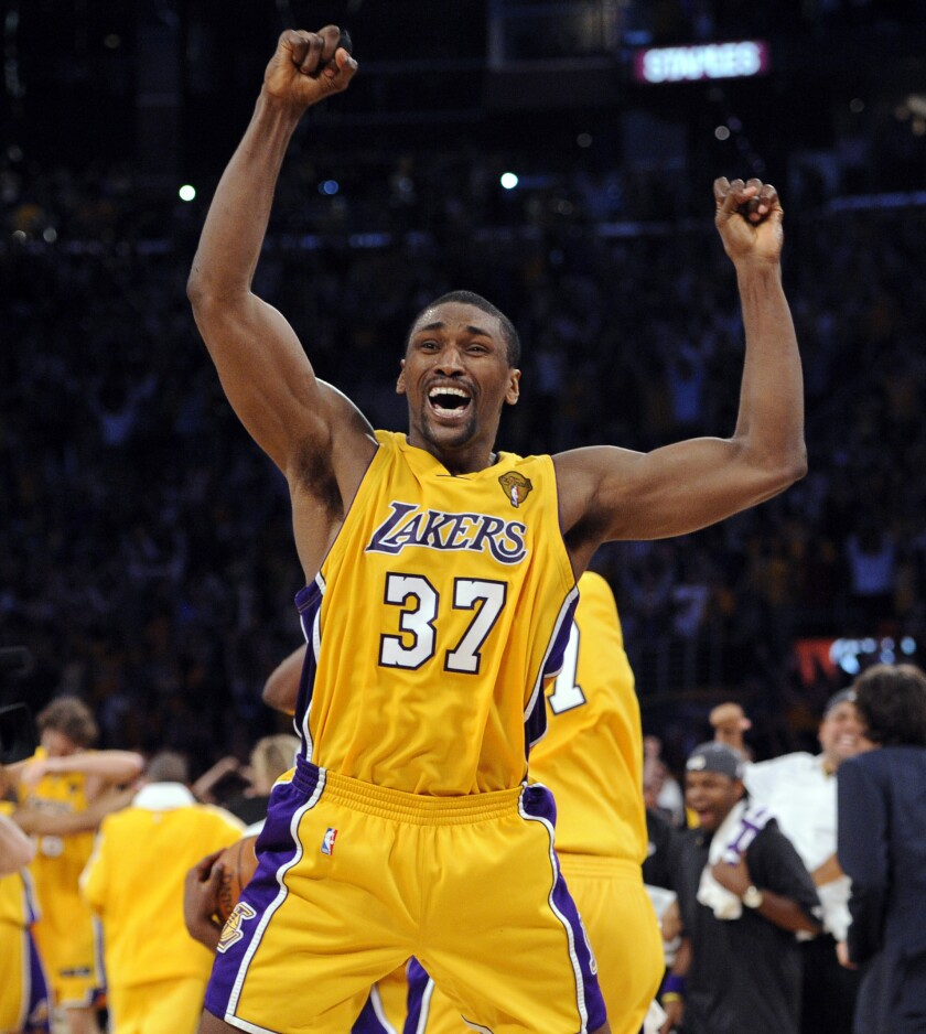 Ron Artest reacts after making a three-point shot against the Celtics with 1:01 left in the fourth quarter of Game 7 of the 2010 NBA Finals to help clinch a win.