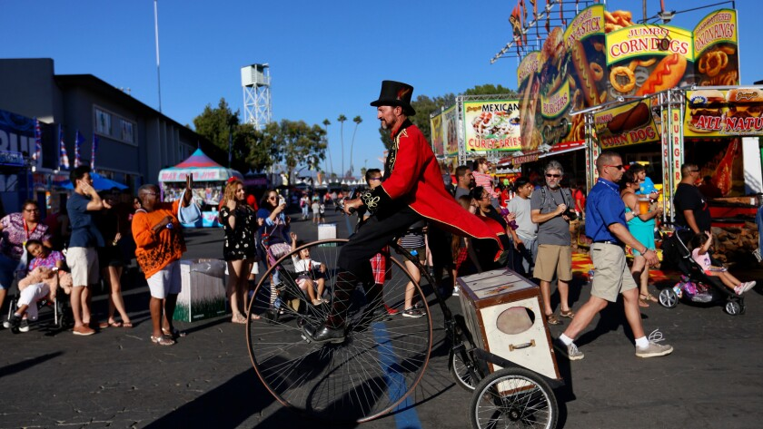 A parade makes its way through the L.A. County Fair at the Fairplex in Pomona.