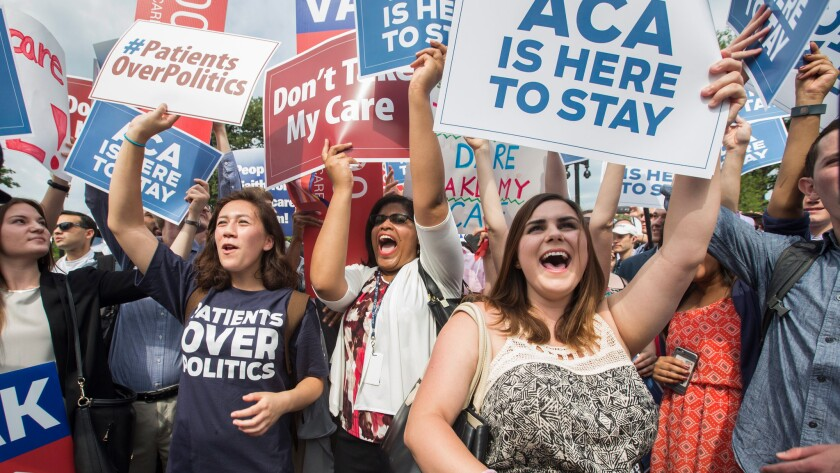 Obamacare supporters rally at the U.S. Supreme Court in 2015 after a court ruling upheld a key element of the healthcare law.
