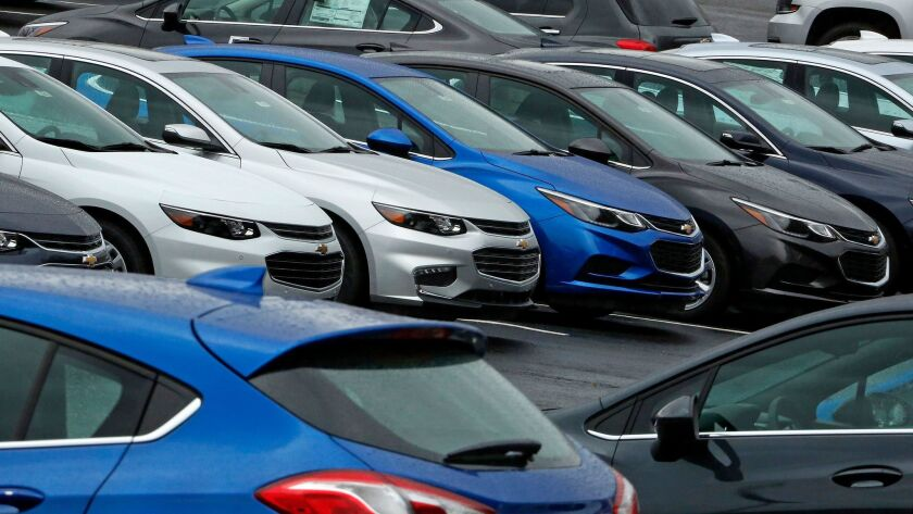 Chevrolet cars sit on the lot of a dealer in Pittsburgh this year.