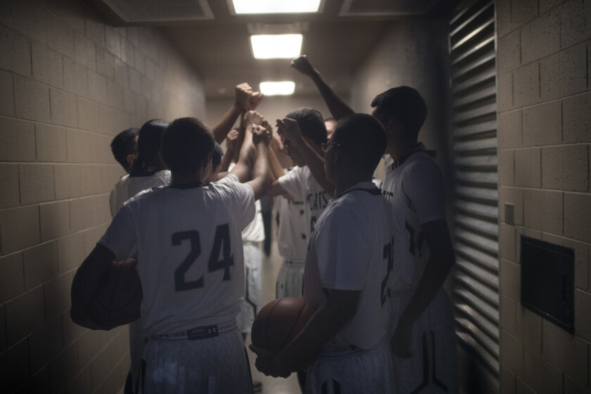 Players on the Chinle High Wildcats varsity basketball team get ready for a game against Holbrook High School.