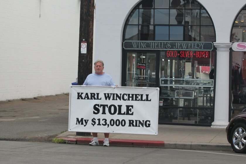 James Hall stood in front of Winchell Jewelry Designs on Wall Street for nearly two weeks in November 2013 to call attention to his dispute with the store owner. The pair hope to resolve the issue in court on April 10.  Pat Sherman