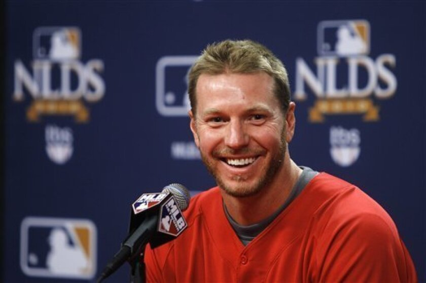 Philadelphia Phillies pitcher Roy Halladay laughs after answering a question during a baseball news conference, Tuesday, Oct. 5, 2010, in Philadelphia. The Phillies host the Cincinnati Reds in Game 1 of the National League Divisional Series on Wednesday. Halladay is scheduled to start Game 1. (AP Photo/Matt Slocum)