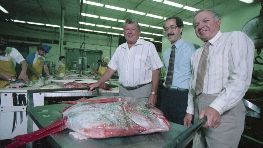 In a May 1986 file photo, from left, Tod, Rick and Anthony Ghio pose with the Catch of the Day in the kitchen of the old Lovelock Street kitchen at Anthony's Fish Grotto.
