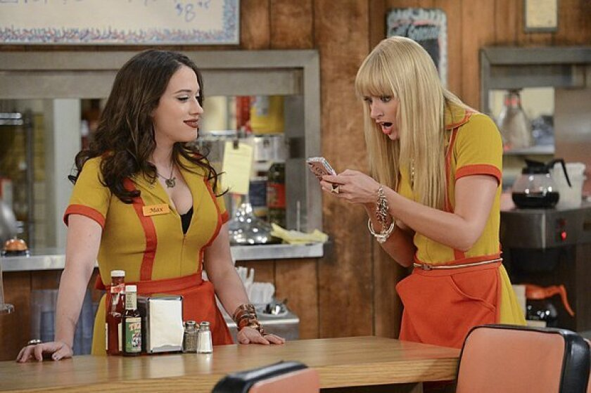 """Kat Dennings, left, and Beth Behrs, stars of CBS' """"2 Broke Girls,"""" will cohost the People's Choice Awards in January."""