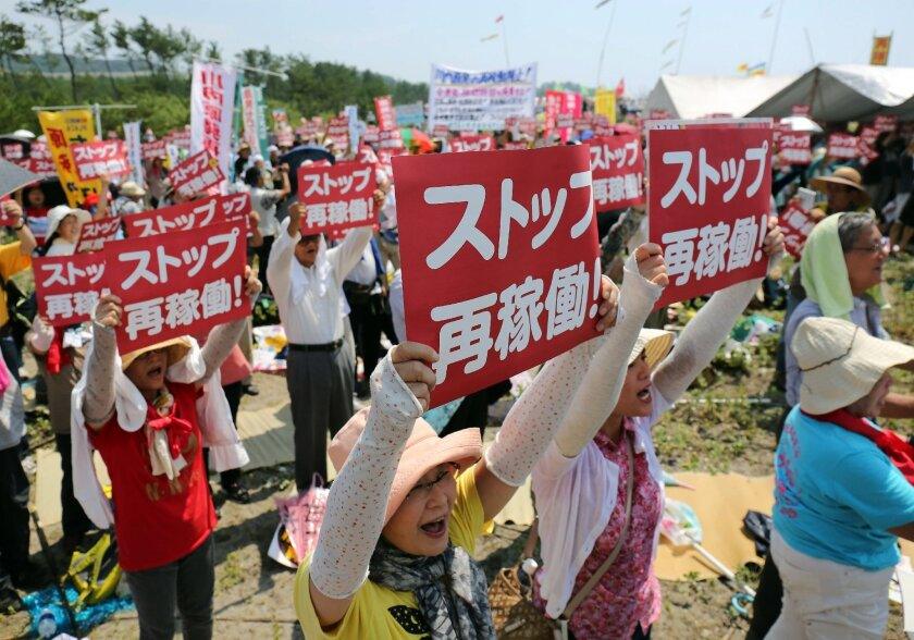Protesters rally Aug. 9 on Japan's southern island of Kyushuanti against the decision to restart a reactor at the Kyushu Electric Power Co.'s Sendai nuclear plant.