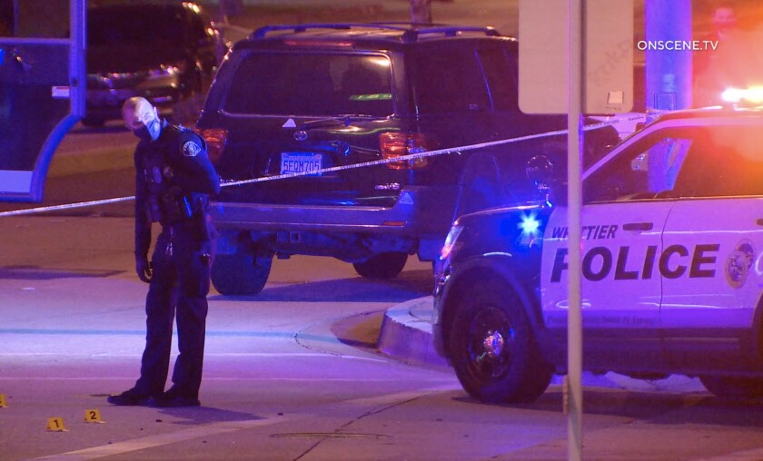 A man suspected of stabbing two people was shot and killed by a police officer in Santa Fe Springs Monday night.
