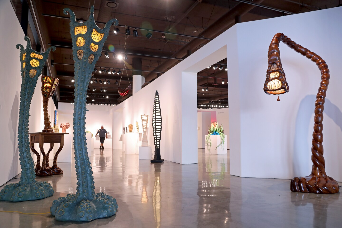 Octo Lamps, 2016, left, and Bent Lily Floor Lamp, 2007, far right, by Ashoke Chhabra.