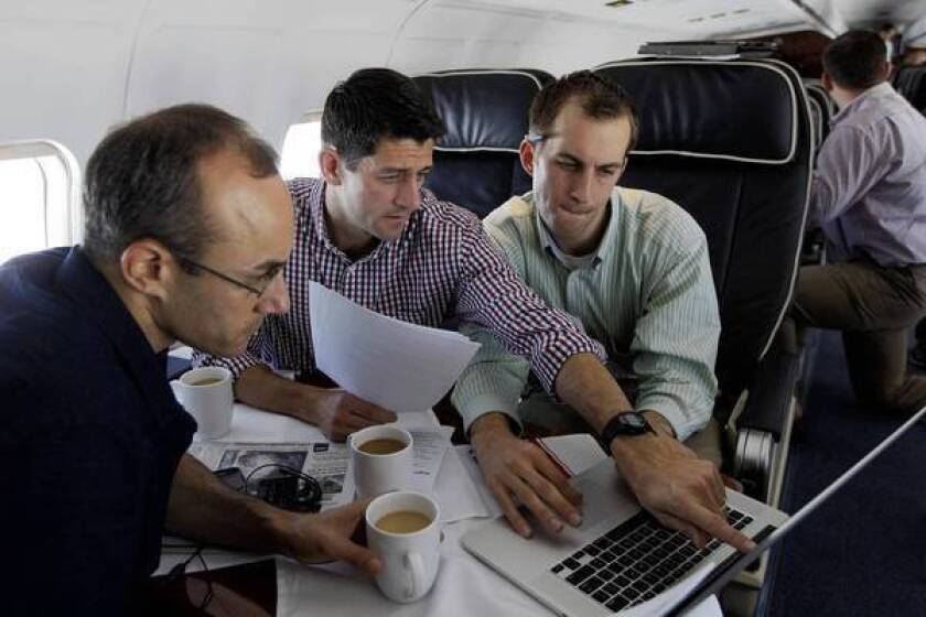 Paul Ryan, center, works en route to Tampa, Fla., on the speech he will deliver Wednesday at the Republican National Convention.