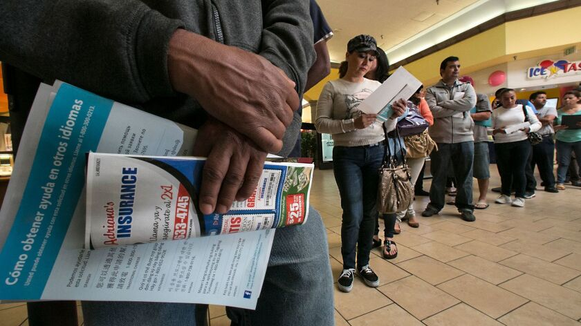 People line up at the Panorama Mall in Panorama City to sign up for Covered California ahead of a 2014 deadline.