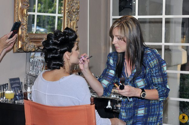 Mandy Guillen applies make up to a model