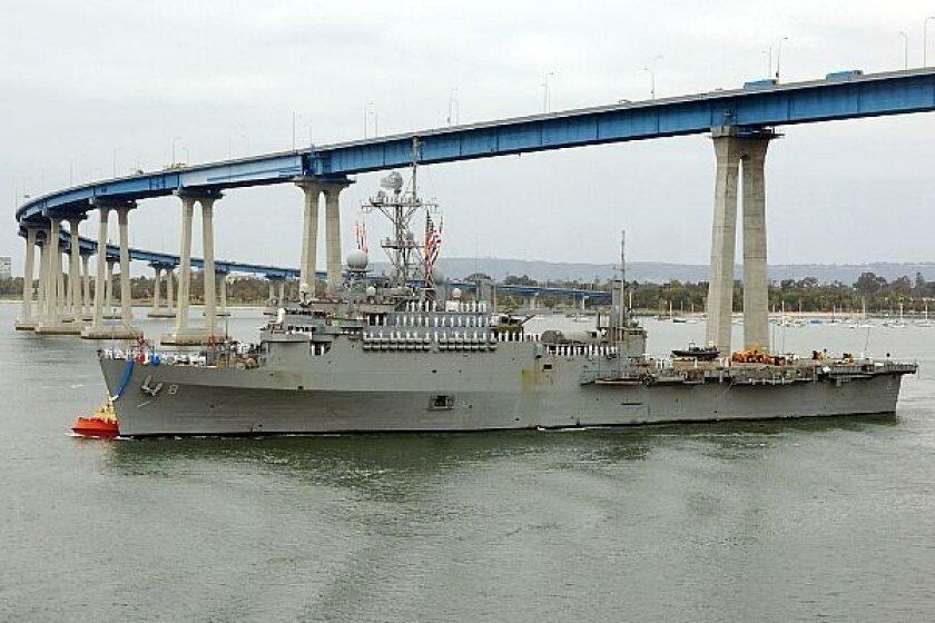 Amphibious transport dock Dubuque passes under the Coronado Bay Bridge. (US Navy photo)