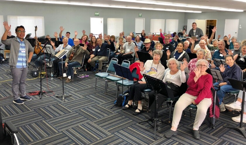 Music director Matt Ignacio (far left) and members of Tremble Clefs San Diego, a singing group for people with Parkinson's disease and their caregivers. Because of the coronavirus, the members are now rehearsing and socializing online.