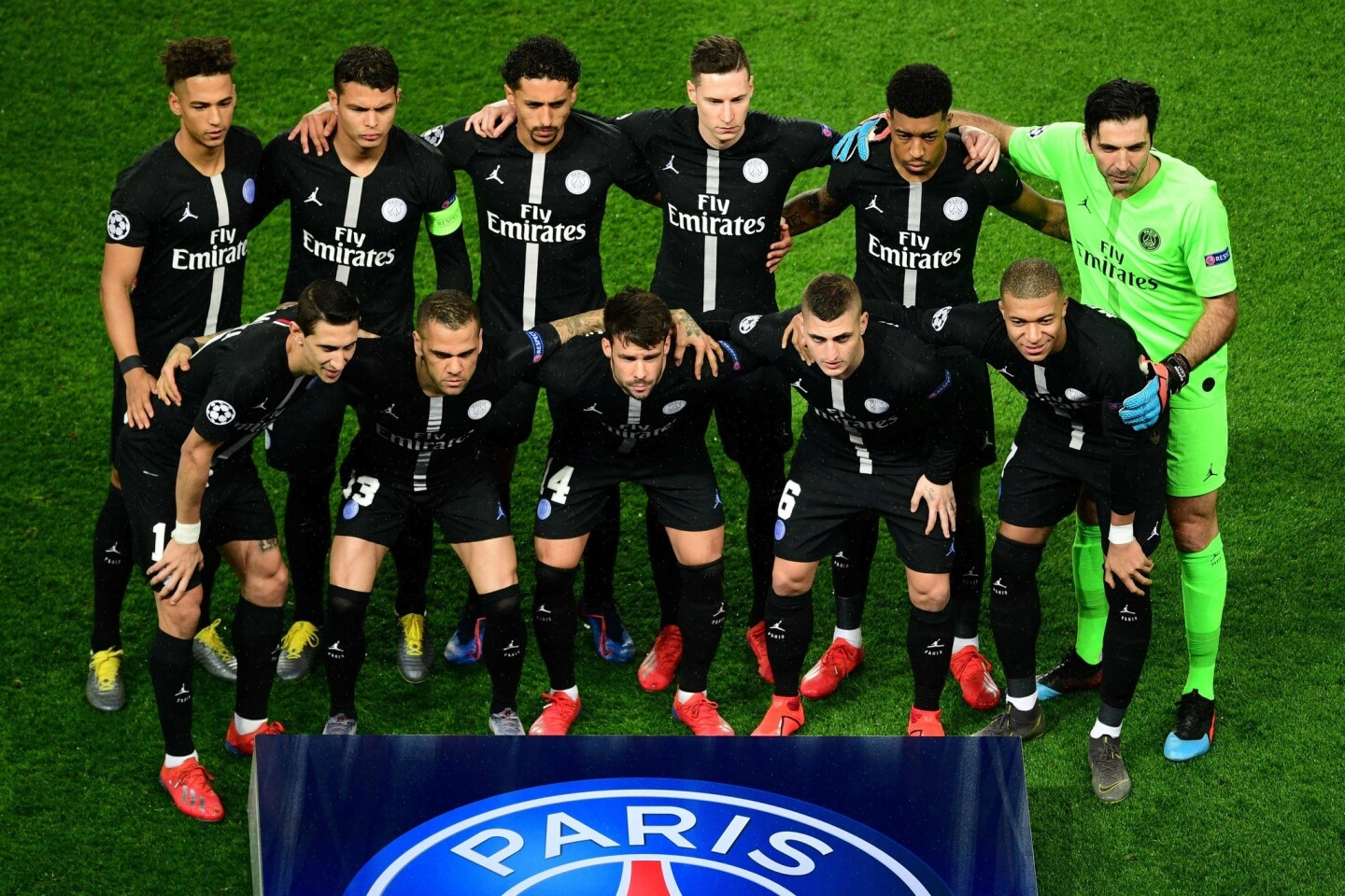 Paris Saint-Germain's players pose for a team picture prior to the UEFA Champions League round of 16 second-leg football match between Paris Saint-Germain (PSG) and Manchester United at the Parc des Princes stadium in Paris on March 6, 2019: (Front row from L to R) Paris Saint-Germain's Argentine midfielder Angel Di Maria, Paris Saint-Germain's Brazilian defender Dani Alves, Paris Saint-Germain's Spanish defender Juan Bernat, Paris Saint-Germain's Italian midfielder Marco Verratti, Paris Saint-Germain's French forward Kylian Mbappe (back row from L to R) Paris Saint-Germain's German defender Thilo Kehrer, Paris Saint-Germain's Brazilian defender Thiago Silva, Paris Saint-Germain's Brazilian defender Marquinhos, Paris Saint-Germain's German midfielder Julian Draxler, Paris Saint-Germain's French defender Presnel Kimpembe and Paris Saint-Germain's Italian goalkeeper Gianluigi Buffon. (Photo by Martin BUREAU / AFP)MARTIN BUREAU/AFP/Getty Images ** OUTS - ELSENT, FPG, CM - OUTS * NM, PH, VA if sourced by CT, LA or MoD **