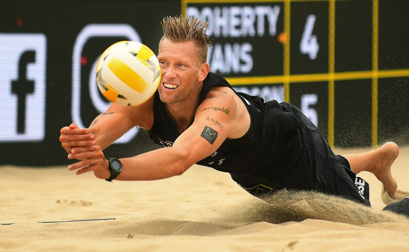 Casey Patterson dives for the ball during a volleyball match at the Hermosa Beach Open in July.