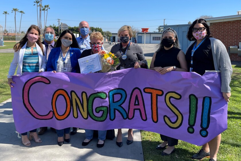 Anne Brasie, with bouquet of flowers, is one of Ocean View School District's 2021 Teachers of the Year.