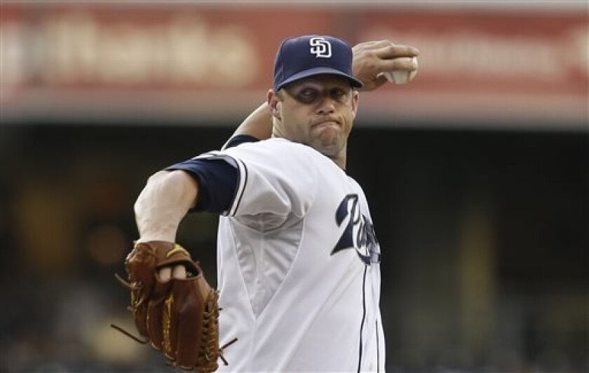 San Diego Padres starting pitcher Eric Stults works the first inning against the Colorado Rockies in a baseball game in San Diego, Tuesday, July 9, 2013. (AP Photo/Lenny Ignelzi)