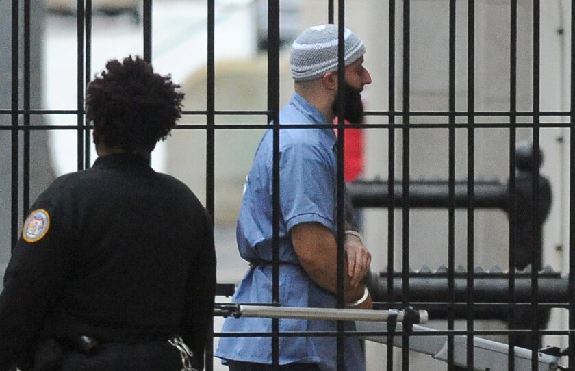 FILE - In a Wednesday, Feb. 3, 2016 file photo, Adnan Syed enters Courthouse East in Baltimore prior to a hearing. The hearing, scheduled to last three days before Baltimore Circuit Judge Martin Welch, is meant to determine whether Syed's conviction will be overturned and case retried.  After spend