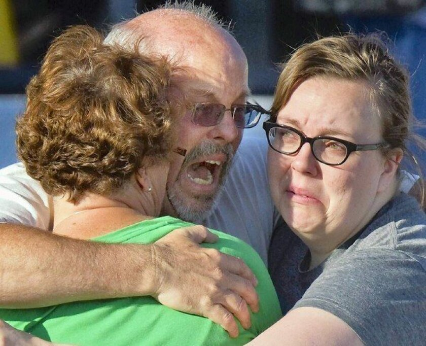Gunman kills at least 12 in rampage at Colorado movie theater