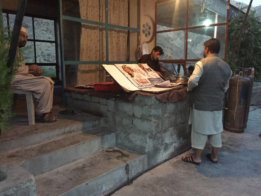 At a roadside restaurant outside Kabul, Gula Jan, far left, sells hashish to a wide array of clients.