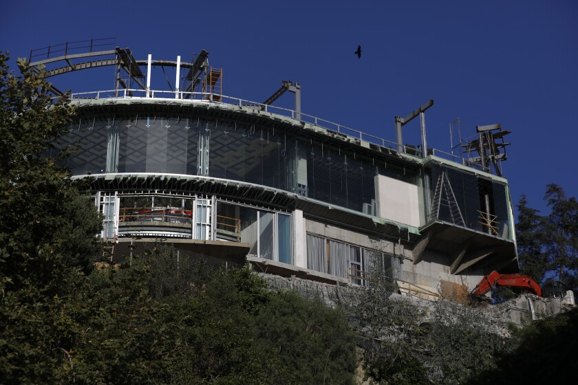 The unfinished mansion on Strada Vecchia Road in Bel-Air.