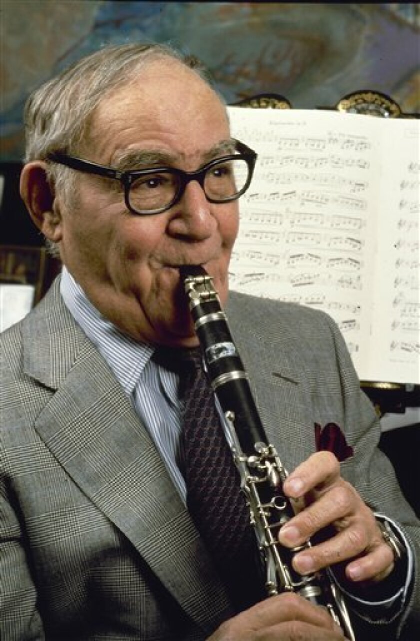 FILE - In this Feb. 1986 file photo, Jazz clarinetist Benny Goodman, performs in his New York apartment. (AP Photo/Carlos Rene Perez, file)