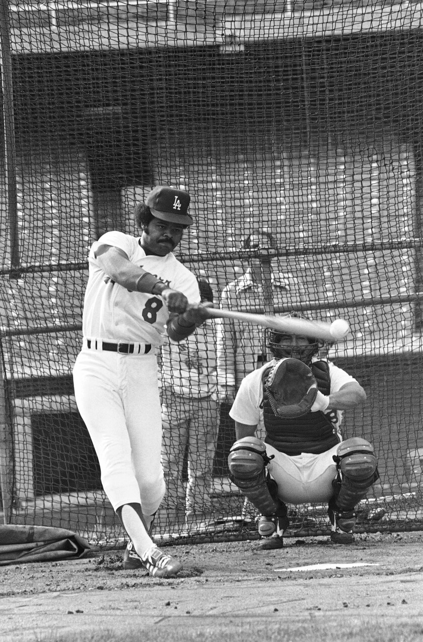 Dodgers outfielder Reggie Smith socks one away from bullpen catcher Mark Cresse during the team's opening workout in 1978.